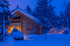 Winter Evening and the House in the Woods Royalty Free Stock Photo