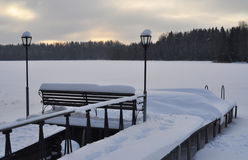Winter evening on lake Stock Photos