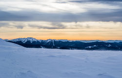 Winter evening in mountains. Royalty Free Stock Image