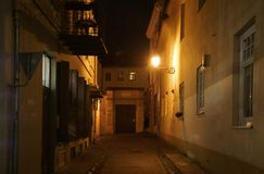 Winter evening on a narrow street in Vilnius. Winter evening on a narrow street in Old Vilnius stock images