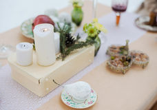 Winter evening outdoor candlelit dinner. Event. Christmas dinner, drinks and snacks on vintage tableware Stock Photography