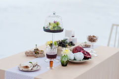 Winter evening outdoor candlelit dinner. Event. Christmas dinner, drinks and snacks on vintage tableware Royalty Free Stock Photography