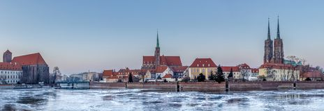 Winter evening over the Odra frozen ice, view of Ostrow Tumski - Wroclaw, Poland. Winter evening over the Odra frozen ice, view of Ostrow Tumski royalty free stock photo