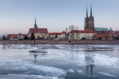 Winter evening over the Odra frozen ice, view of Ostrow Tumski - Wroclaw, Poland. Winter evening over the Odra frozen ice, view of Ostrow Tumski royalty free stock photography