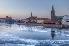 Winter evening over the Odra frozen ice, view of Ostrow Tumski - Wroclaw, Poland. Winter evening over the Odra frozen ice, view of Ostrow Tumski royalty free stock image