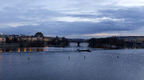 Winter evening Prague City above River Vltava from Charles Bridge, Czech Republic Stock Photo