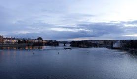 Winter evening Prague City above River Vltava from Charles Bridge, Czech Republic Stock Photography