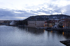 Winter evening Prague City above River Vltava from Charles Bridge, Czech Republic Royalty Free Stock Photo