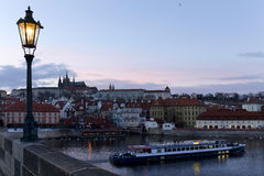 Winter evening Prague City with gothic Castle from Charles Bridge, Czech Republic Royalty Free Stock Images