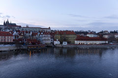 Winter evening Prague City with gothic Castle from Charles Bridge, Czech Republic Stock Photo