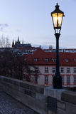 Winter evening Prague City with gothic Castle from Charles Bridge, Czech Republic Stock Photography