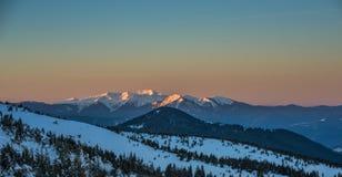 Winter evening scene in Carpathian Mountains Royalty Free Stock Image