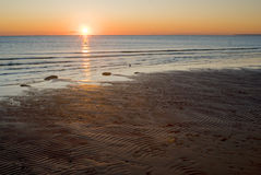 Winter evening on the sea shore. Sunset Stock Images