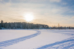 Winter evening on snow-covered river. Royalty Free Stock Photos