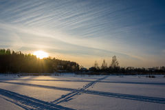 Winter evening on snow-covered river. Stock Photos