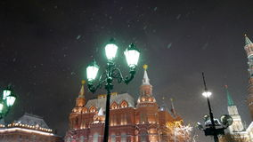 Winter evening. Snow flies past a street lamp in the old style. stock footage