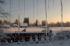 Winter evening in village Stock Images
