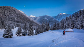Winter expedition in the mountains at sunset. Europe Stock Photography
