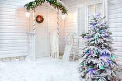 Winter exterior of a country house with Christmas decorations in the American style. Stock Image