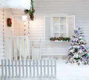 Winter exterior of a country house with Christmas decorations in the American style. Stock Photography