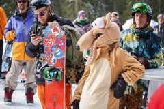 Winter extreme sports festival in mountain snow park. BUKOVEL,UKRAINE-19 MARCH,2018: Rider girl wearing funny kigurumi squirrel costume in camp.Winter action royalty free stock images