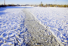 Winter fairway on a large river. In the winter fairway is laid on a large river  for the passage of ships in port Royalty Free Stock Photography