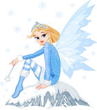 Winter fairy. Beautiful Winter fairy sitting on ice rock Royalty Free Stock Images