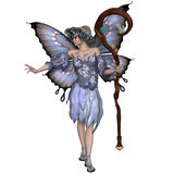 Winter Fairy. A fairy is a mythical creature of folklore and mystery dressed the colors of winter Stock Photography