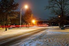 Winter fairy. Night shot of country street under snow in winter season. Winter night snow dwelling area Stock Photos