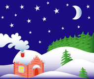 Winter fairy tale. Freezing winter night in the magical forest with warm home and beautiful starry sky Royalty Free Stock Images