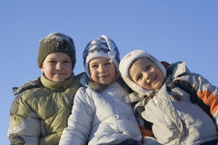 Winter family. Children on snow Stock Photos