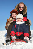 Winter family with sled2 Stock Photography
