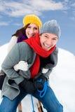 Winter. Family sliding winter couple enjoying season Stock Photography