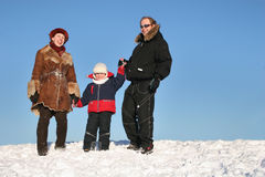 Winter family on snow Royalty Free Stock Photo