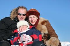 Winter family on snow2 Royalty Free Stock Photos