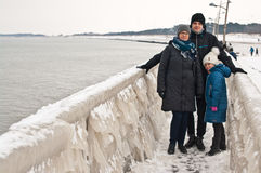 Winter family walk at Darlowo beach Royalty Free Stock Photos