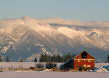Winter Farm and Mountains Stock Photo