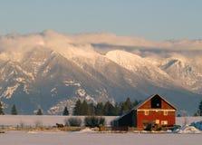 Winter Farm and Mountains Stock Photo