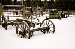 Winter Farmyard. Old farm machinery in a snow-covered farmyard Stock Photo