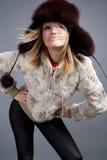 Winter fashion. Beautiful winter fashion girl posing royalty free stock photography