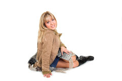 Winter fashion. Young blond girl in the winter jacket Stock Photography