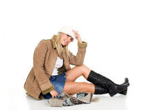 Winter fashion. Young blond girl in the winter jacket Royalty Free Stock Photo