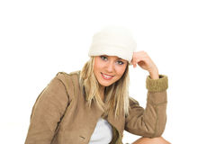 Winter fashion. Young blond girl in the winter jacket Royalty Free Stock Photos