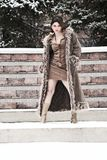 Winter fashion. Girl wearing a long nice coat in winter Royalty Free Stock Images