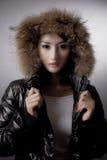 Winter Fashion. Beautiful woman wearing winter jacket Stock Image