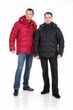 Winter Fashion. Young man in down jacket royalty free stock photo