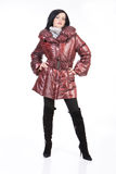 Winter Fashion. Young woman in down coat royalty free stock photo