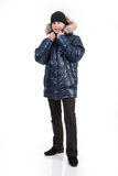 Winter Fashion. Young man in down jacket stock photo