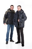 Winter Fashion. Young man in down jacket royalty free stock images