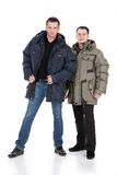 Winter Fashion. Young men in down jacket royalty free stock photography